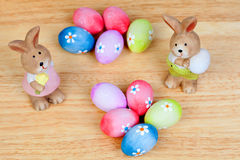 Funny rabbits ceramic with Easter eggs decorated with daisies Royalty Free Stock Images