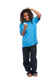 Funny rasta boy playing with cellphone Royalty Free Stock Image