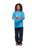 Funny rasta kid playing with cellphone in studio Stock Images