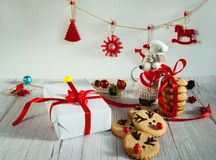 Free Funny Rat In A Hat And Apron Packs Homemade Gingerbread Cookies In The Form Of A Santa Claus Deer In A Box With Red Ribbons. Felt Royalty Free Stock Photo - 164183185