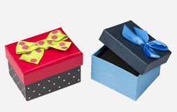 Funny red black gift box with green ribbon and Blue Gift box with ribbon isolated on white Royalty Free Stock Photos