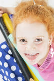 Funny Red-haired Caucasian Girl Making Faces. Against White Stock Images