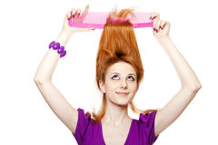 Funny red-haired girl with big comb. Stock Images
