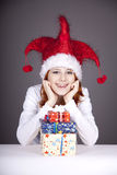 Funny red-haired girl in christmas cap Stock Photo