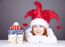 Funny red-haired girl in christmas cap Stock Images