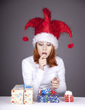 Funny red-haired girl in christmas cap Royalty Free Stock Photography