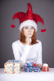 Funny red-haired girl in christmas cap Stock Photography
