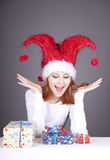 Funny red-haired girl in christmas cap Royalty Free Stock Image