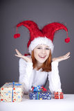Funny red-haired girl in christmas cap Royalty Free Stock Images