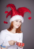 Funny red-haired girl in christmas cap Stock Image