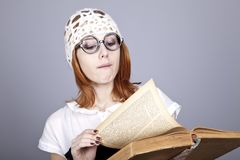 Funny red-haired girl with old book. Stock Photography