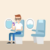 Funny red head nerd sitting on the plane Royalty Free Stock Photography