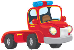 Funny red old-styled truck. Funny red old-styled toy tow truck with blue blinker. Children illustration Royalty Free Stock Photo
