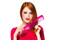 Funny redhead girl with big comb. stock images