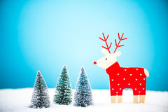 Funny reindeer in miniature forest. Cute Christmas postcard Royalty Free Stock Photography