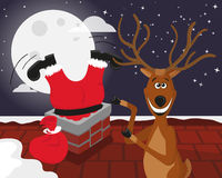 Funny reindeer with Santa on the roof Royalty Free Stock Photos