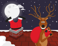 Funny reindeer with Santa on the roof. Funny reindeer picked up Santas red bag with gifts while Santa Claus climbing down the chimney on the roof behind him royalty free illustration