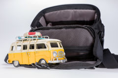 Funny retro car with surfboard and big suitcase Royalty Free Stock Photo