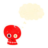 Funny retro cartoon skull with thought bubble Royalty Free Stock Image