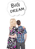 Funny retro family couple embracing and looking on dream Royalty Free Stock Photography