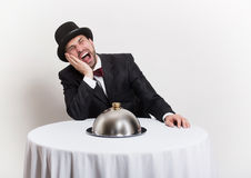 Funny retro gentleman sitting at the table Royalty Free Stock Images