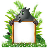 Funny rhino with board Royalty Free Stock Photo