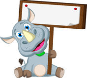 Funny rhino cartoon with blank sign for you design Stock Photo