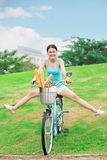 Funny rider. Excited girl having fun riding down the slope Stock Images