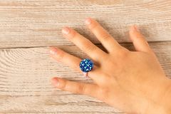 Free Funny Ring On A Little Girl`s Hand.  On Wooden Background Stock Images - 144639714