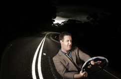 Funny road rage man in car accident. Road rage man beeping horn while behind the wheel of a vehicle on a dark road. Car accident Stock Photography