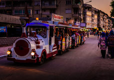 Funny Road Train. Urban train is terrestrial vehicle designed in a stylized shape of a steam train for the inner city tours on Cinarcik town. Cinarcik town is a Stock Image