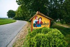 Funny roadside signboard. Outdoor roadside signboard. good bye by Slovenian royalty free stock images