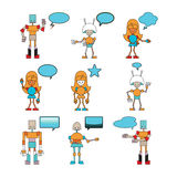 Funny robots decorated with comics bubbles Stock Image