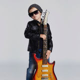 Funny rock child with guitar.fashionable little boy in sunglasses Royalty Free Stock Photography