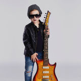 Funny rock child with guitar.fashionable little boy Royalty Free Stock Photos
