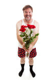 Funny Romantic Guy - Full Body Isolated. Humorous photo of a scruffy looking middle aged man in his underwear holding a bouquet of roses for his sweetie. Full royalty free stock photos
