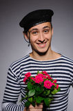 Funny romantic sailor man holding rose. Funny emotional romantic sailor man holding rose flowers prepared for a date Royalty Free Stock Images
