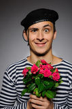 Funny romantic sailor man holding rose. Funny emotional romantic sailor man holding rose flowers prepared for a date Stock Photo