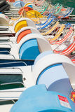 Funny row of colorful pedal boat. Stock Photo