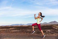 Funny runner athlete goofy woman running fun. Funny runner athlete goofy woman having fun jogging on outdoor mountain nature trail. Running fitness motivation royalty free stock photo