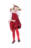 Funny running girl with pigtails Stock Photo
