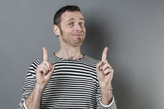 Funny 40s man giving advice with fingers Stock Photo