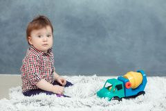 Funny sad baby toddler boy at home Royalty Free Stock Images