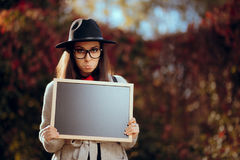 Funny Sad Pouty Student Holding a Blackboard Sign Royalty Free Stock Photography