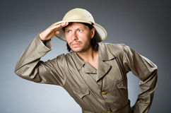 Funny safari hunter against background Stock Images