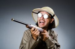 Funny safari hunter with the rifle Stock Photography