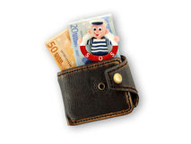 Funny sailor  in a purse Stock Photos