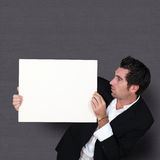 Funny salesman holding whiteboard Stock Photo