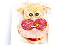 Funny sandwich in the cow shape. On the plate Royalty Free Stock Photos