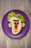 Funny sandwich face on plate Stock Photos
